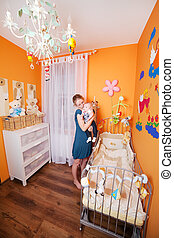 Mother with child in a Baby Room