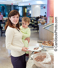 mother with child in buffet