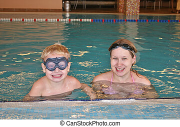 mother with child in covered pool