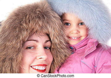 mother with child in furry hats