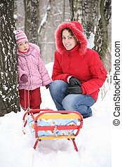 mother with child in park at winter 2