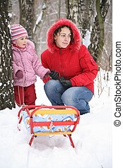 mother with child in park at winter 3