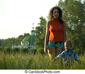 mother with child on meadow