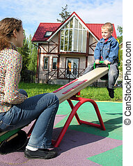 mother with child on seesaw and home
