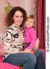 mother with child on the lap in the room