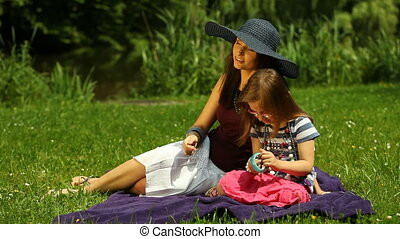 Mother with child on the meadow