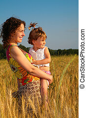 Mother with  child on  wheat field