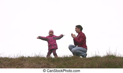 mother with child play on meadow