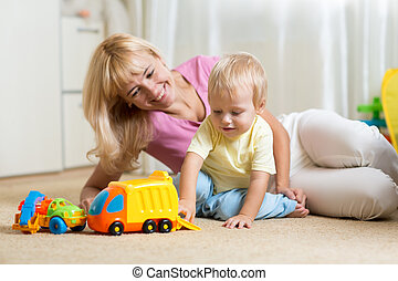 mother with child play together at home