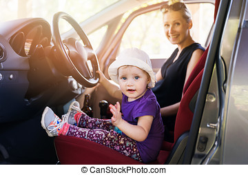 mother with child playing in the car