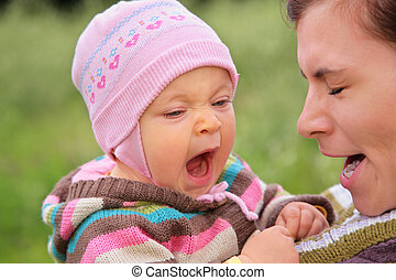 Mother with  child they yawn