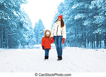 Mother with child walking in snowy day