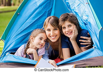 Mother With Children Camping In Park