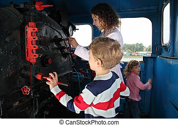 Mother with children in locomotive cabin