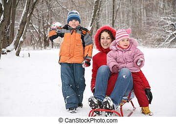 mother with children in park at winter