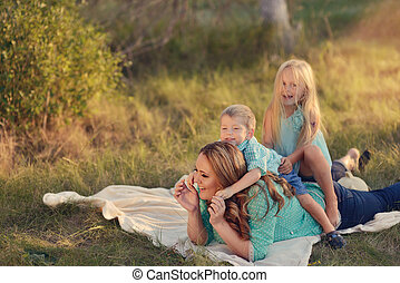 mother with children in the woods - in the forest in a...