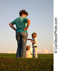 mother with children meadow sundown