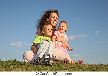 mother with children on grass