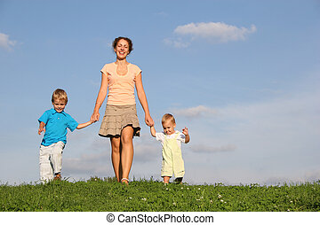 mother with children on meadow