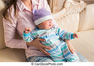 Mother with cute baby at home