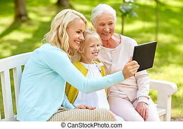 mother with daughter and grandmother at park
