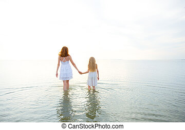 mother with daughter at the sea