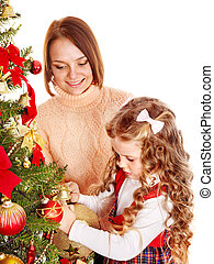 Mother with daughter decorate Christmas tree.