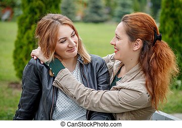 Mother with daughter hugging in park