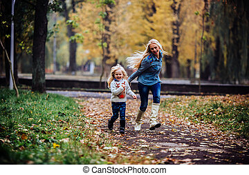 Mother with daughter in autumn park - mother and daughter ...