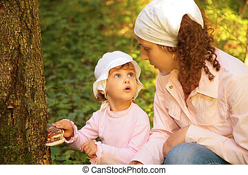 Mother with daughter in forest