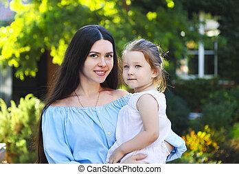 Mother with daughter in garden