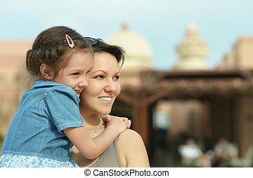 Mother with daughter in summer park