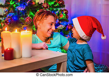 Mother with daughter in the new year's interior.