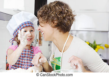 Mother with daughter joyful cooking - Happy mother with ...