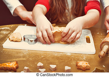 Mother with daughter making Christmas cookies