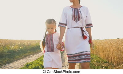mother with daughter - Mom and daughter on a dirt road