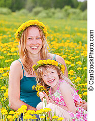 Mother with daughter outdoors - Young pregnant woman with...