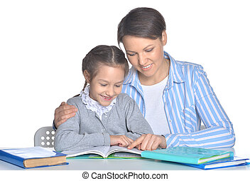 mother with daughter reading books