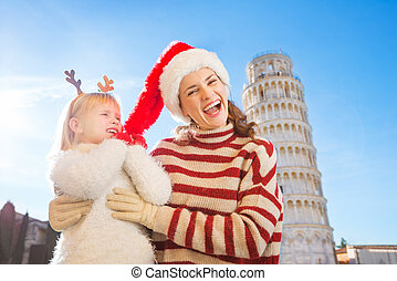 Mother with daughter spending Christmas time in Pisa, Italy
