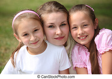 Mother with daughters outdoor in summer