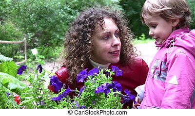 mother with girl and flowers