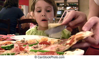 Mother with girl and pizza