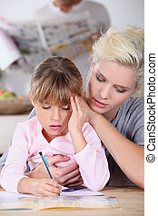 Mother with girl doing homework