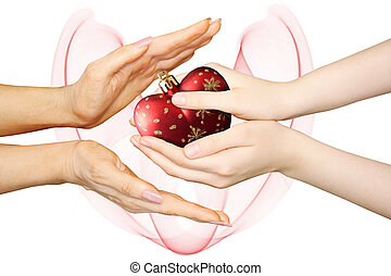 mother with girl hands holding new year christmas heart collage