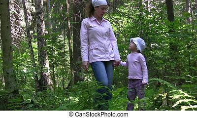 mother with girl in wood