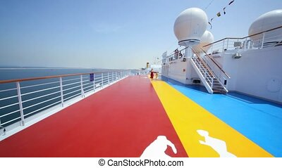 mother with girl runs on deck of cruise liner