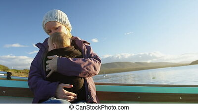 Mother with her baby travelling on motor boat 4k - Mother...