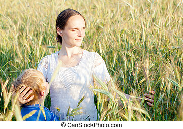 Mother with her child in field