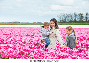 Mother with her child in tulips field
