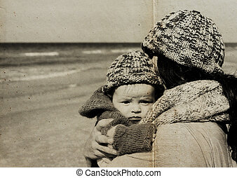 mother with her child on the beach